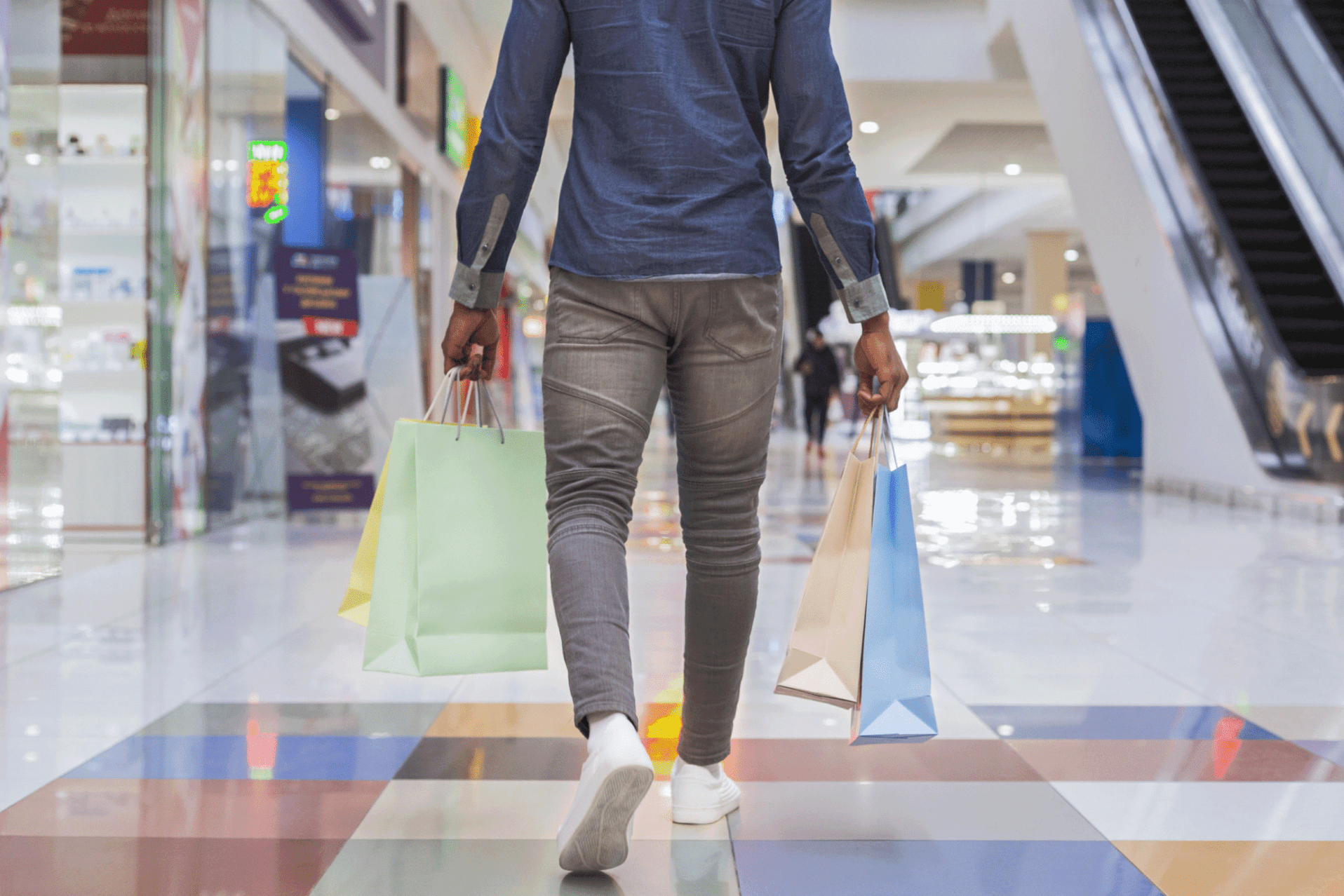 man and gift card and shopping