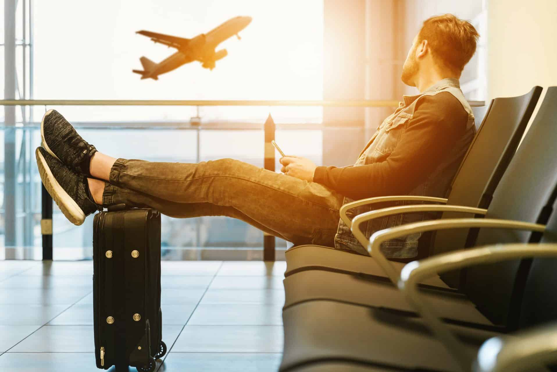 man and airplane and travel deals
