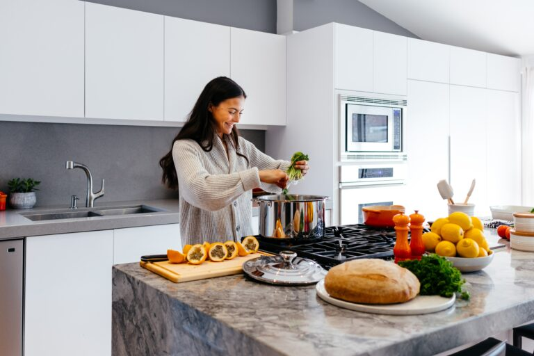woman cooking meal kit delivery in kitchen